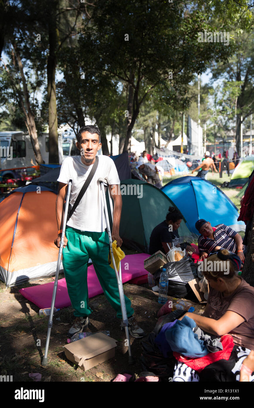 """Mexico City, Mexico. 8th November, 2018. Portrait of Rafael, 33, a Honduran migrant at the Jesus Martinez stadium in Mexico City, Mexico. Rafael is from Ocotepeque, Honduras. He has been traveling for 26 days and arrived in Mexico City three days ago. He joined the caravan at the Honduras-Guatemala border. """"Walking is hard but I was given a wheelchair, which has made my journey a bit easier"""", he says. He left because there were no job opportunities for him in Honduras, especially because he is disabled. Credit: Benedicte Desrus/Alamy Live News Stock Photo"""