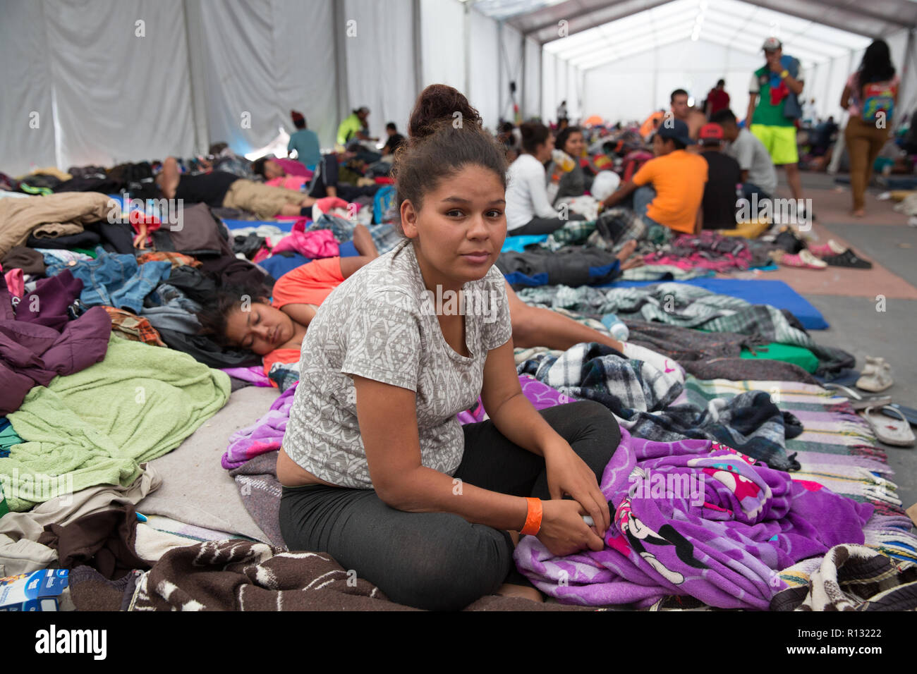 "Mexico City, Mexico. 8th November, 2018. Portrait of Norma, 22, a Honduran migrant at the Jesus Martinez stadium in Mexico City, Mexico. Norma joined the caravan in Tapachula, in the southern Mexican state of Chiapas, where she had been living for three years with her husband, who is Mexican and in the military. She is travelling with her parents and 5 cousins, they want to reach the United States. Norma is four months pregnant and left behind two daughters, a one-year-old in Chiapas and a five-year-old, in Honduras. ""You just can't live in Honduras. Credit: Benedicte Desrus/Alamy Live News Stock Photo"