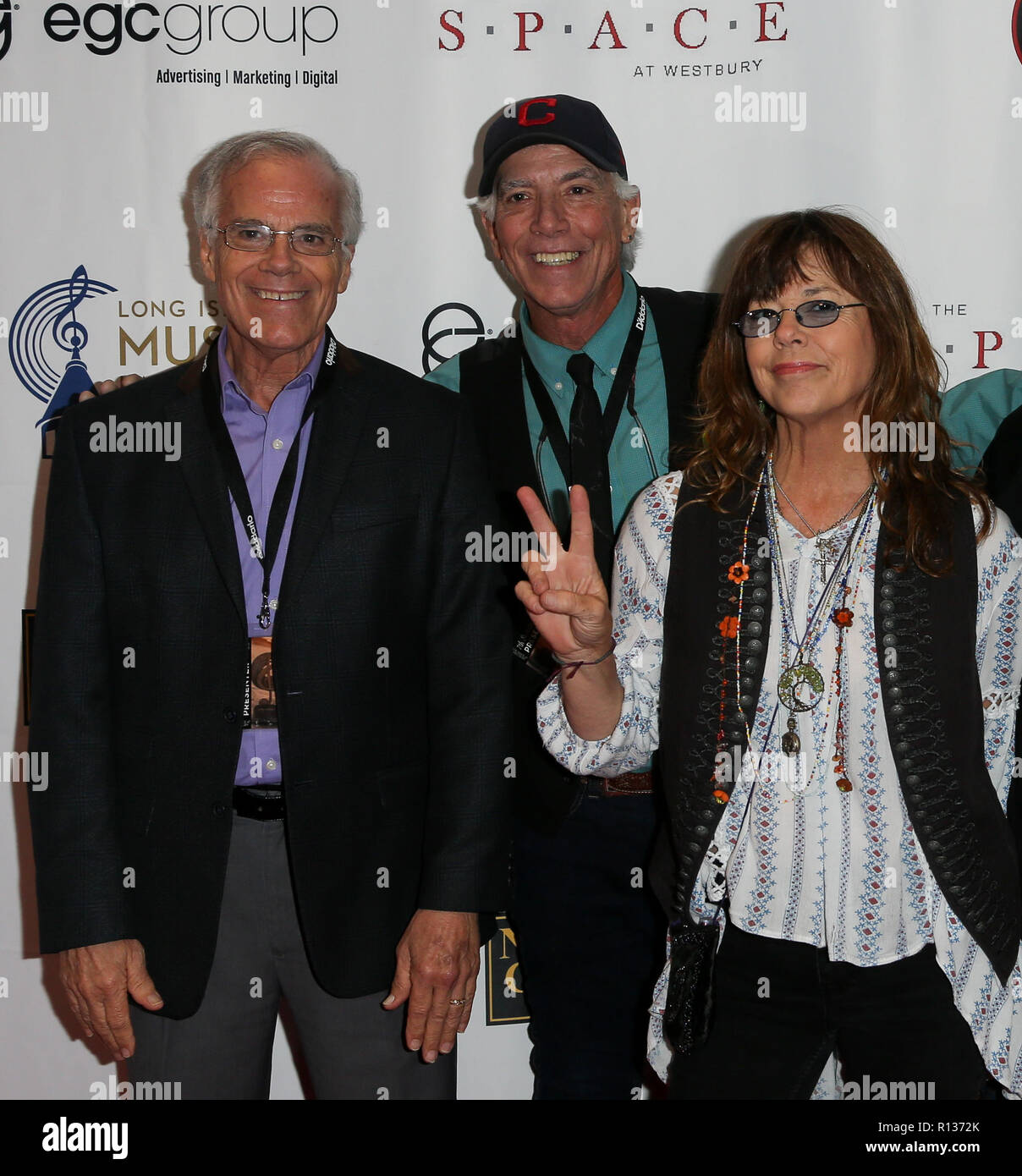 Westbury, United States. 08th Nov, 2018. WESTBURY, NY - NOV 8: (L-R) Paul Cowsill, Bob Cowsill and Susan Cowsill of the Cowsills attend the 2018 Long Island Music Hall of Fame induction ceremony at The Space at Westbury on November 8, 2018 in Westbury, New York. Credit: The Photo Access/Alamy Live News - Stock Image