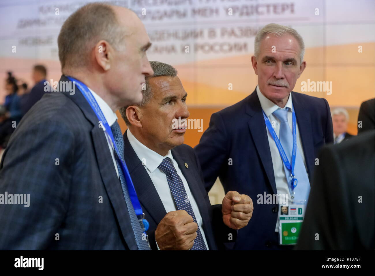 Petropavlovsk, Kazakhstan. 09th Nov, 2018. PETROPAVLOVSK, KAZAKHSTAN - NOVEMBER 9, 2018: The Governor of Russia's Chelyabinsk Region Boris Dubrovsky (L), the President of Russia's Republic of Tatarstan Rustam Minnikhanov (C), and the Governor of Russia's Ulyanovsk Region Sergei Morozov before a plenary meeting at the 15th Russia-Kazakhstan Interregional Cooperation Forum, in Petropavlovsk (Petropavl), North Kazakhstan Region. Mikhail Metzel/TASS Credit: ITAR-TASS News Agency/Alamy Live News - Stock Image