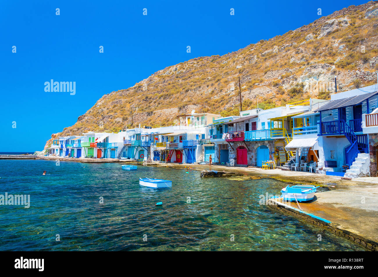 Scenic Klima village (traditional Greek village by the sea, the Cycladic-style) with sirmata - traditional fishermen's houses, Milos island, Cyclades, - Stock Image