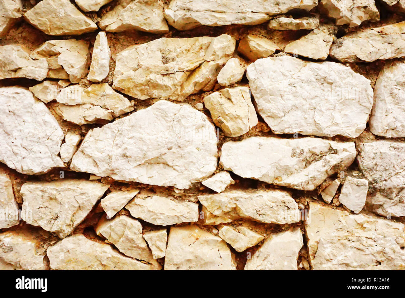 Stone wall surface. Rock wall with cement - Stock Image