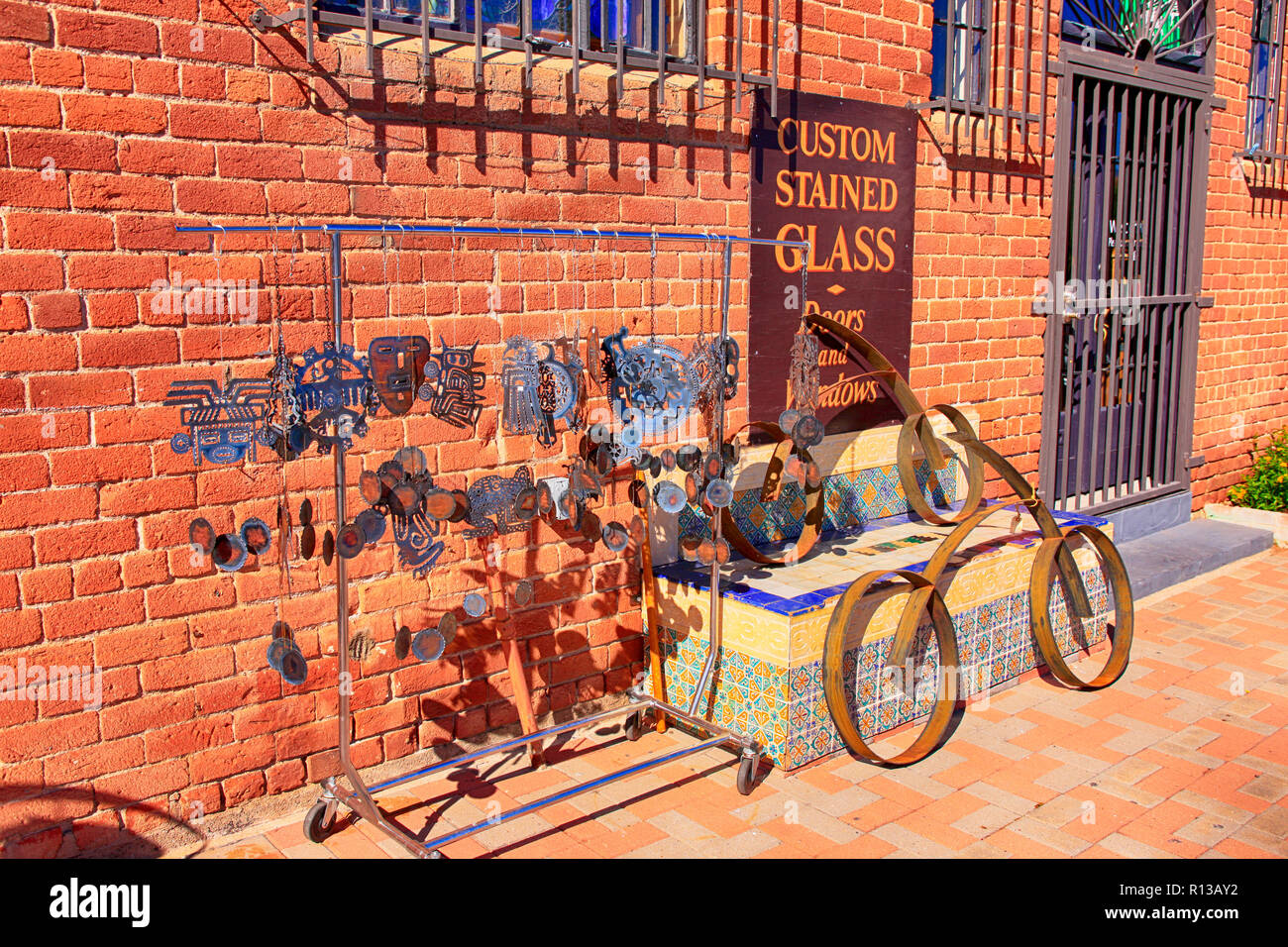 Custom stained glass, pottery and metalwork store in the Lost Barrio shopping district of Tucson, AZ - Stock Image
