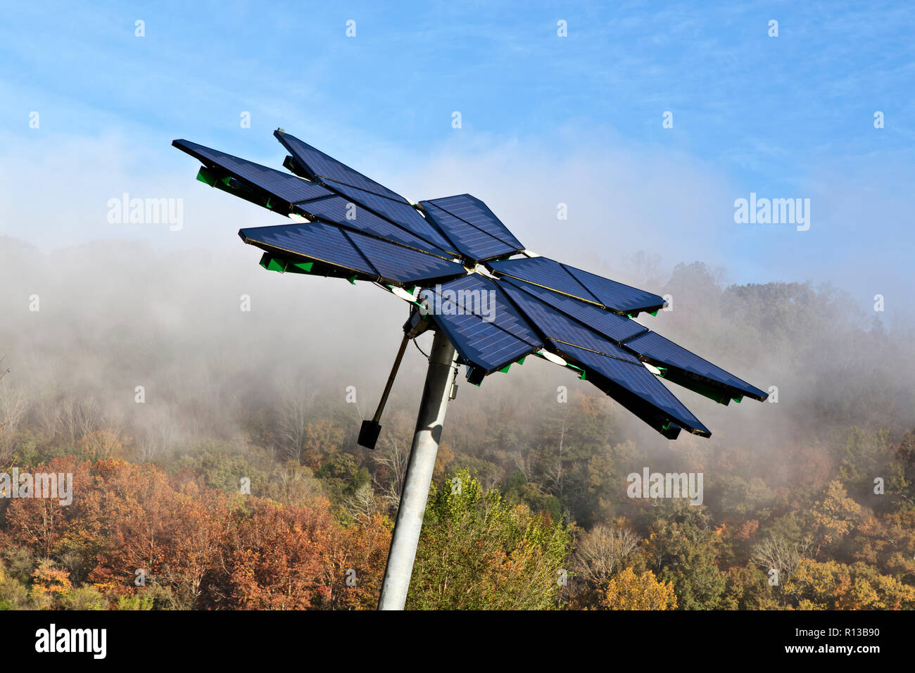 Solar array identified as  'Solar Photovoltaic Flair',  facilitates electric vehicle charging station, dissipating morning fog. - Stock Image