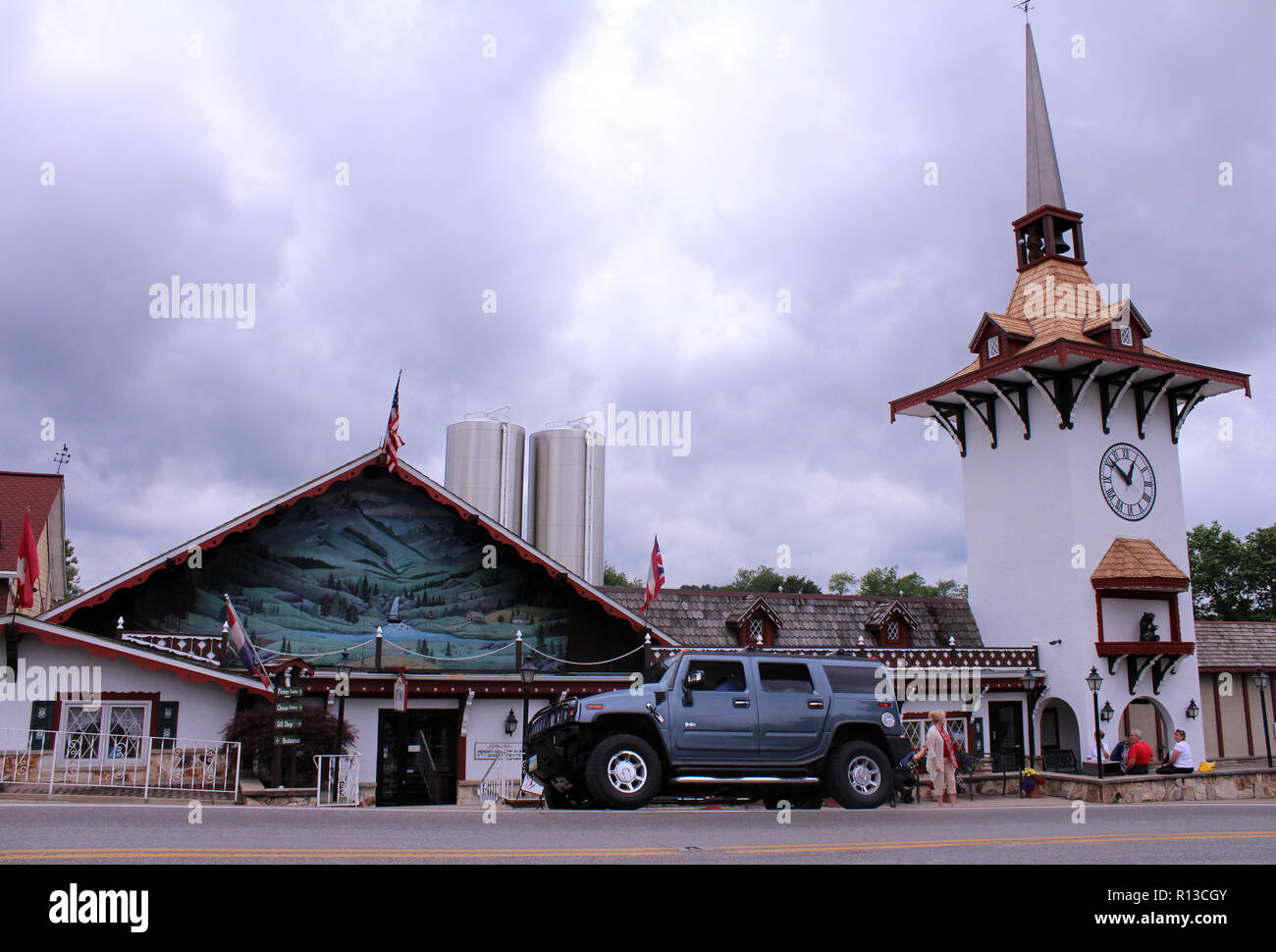 Guggisberg Cheese, home of original baby swiss, housed in imitation Swiss village with giant Hummer vehicle parked in front, near Millersburg, OH, USA Stock Photo