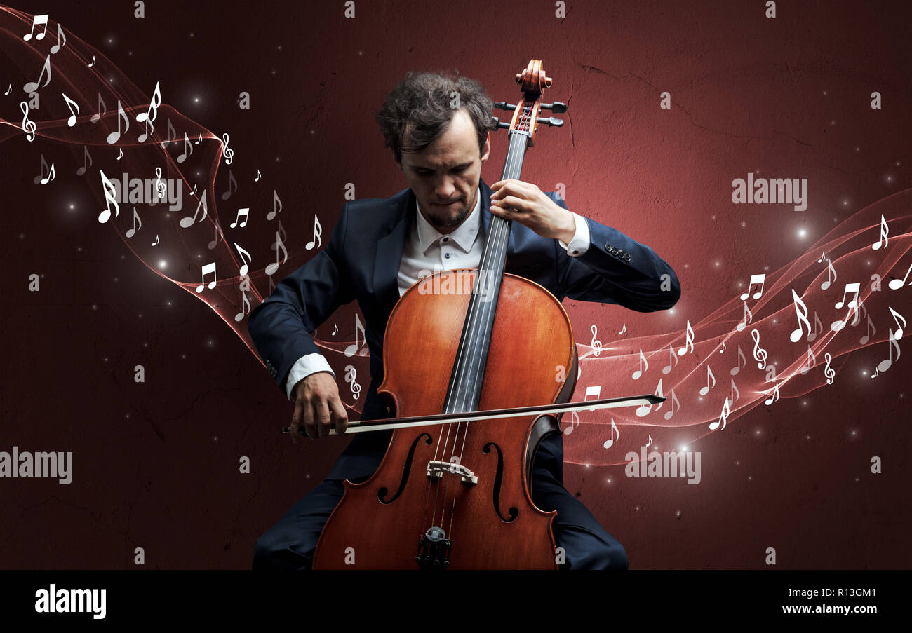 Lonely musical composer with cello and sparkling musical notes around Stock Photo