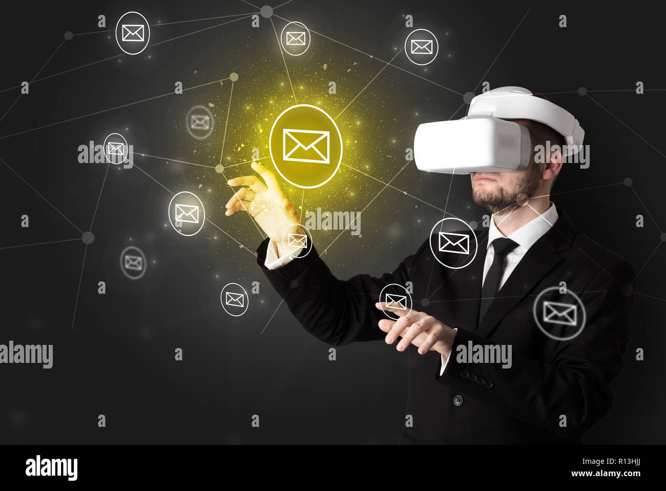 Young businessman in virtual reality glasses organize online network communication - Stock Image