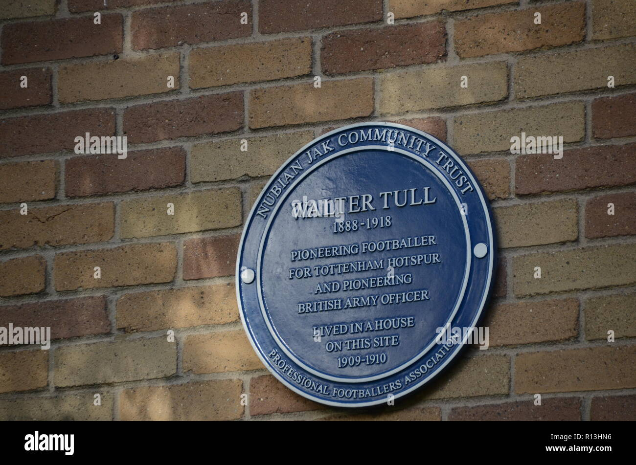 a blue plaque to walter tull on the site he lived in tottenham london UK - Stock Image
