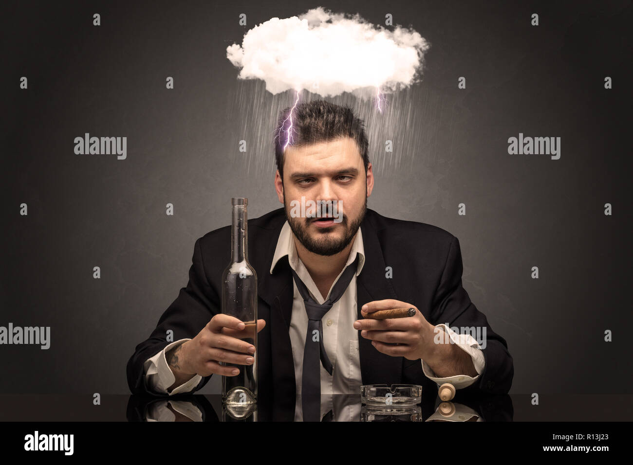 Young drunk disappointed man with hard time overcast concept  - Stock Image