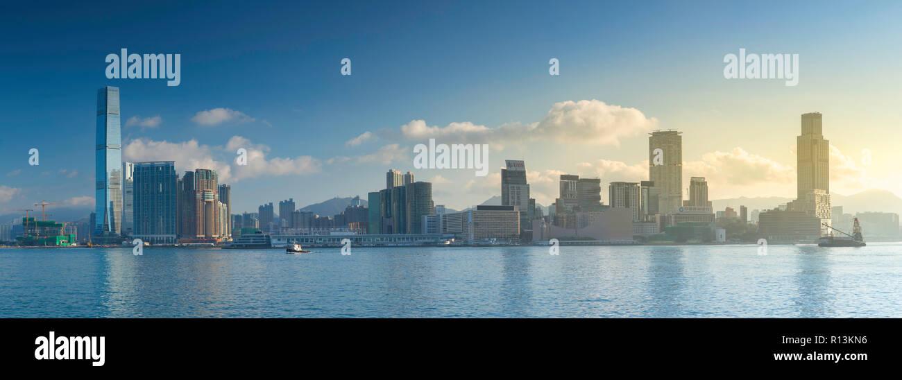 Skyline of Tsim Sha Tsui at sunrise, Kowloon, Hong Kong - Stock Image