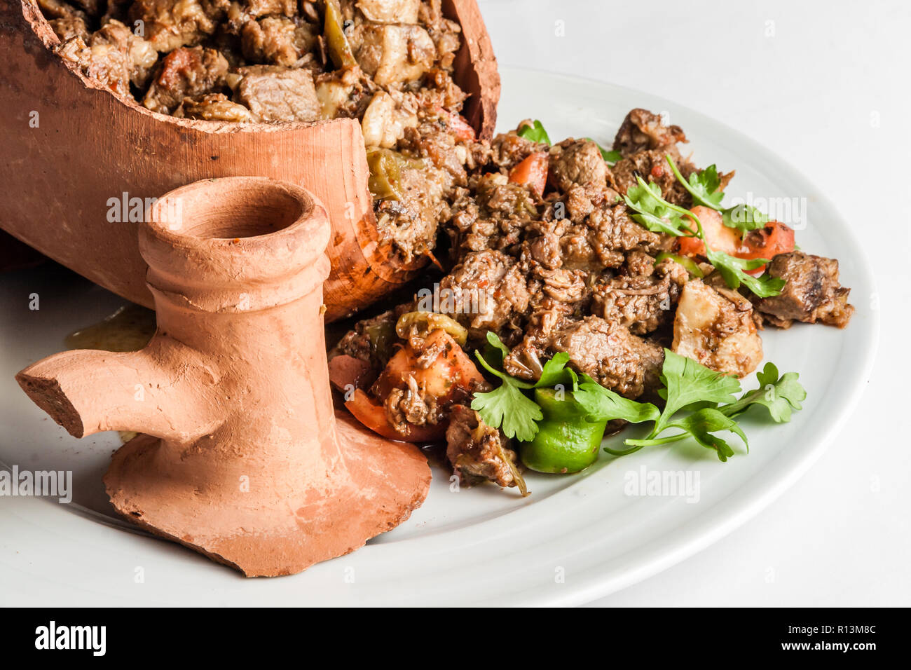 Authentic Turkish Testi Kebab cooked in earthenware waterjug - Stock Image