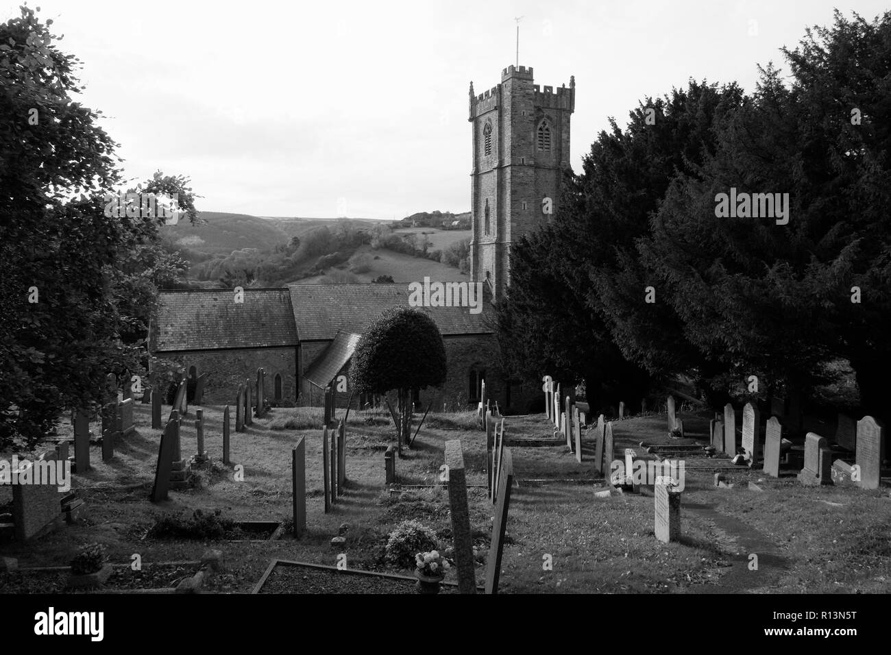 St. Peter's Church, Berrynarbor, Near Ilfracombe, Devon, showing graveyard in foreground in black and white, in winter, in the parish of Exeter. Stock Photo