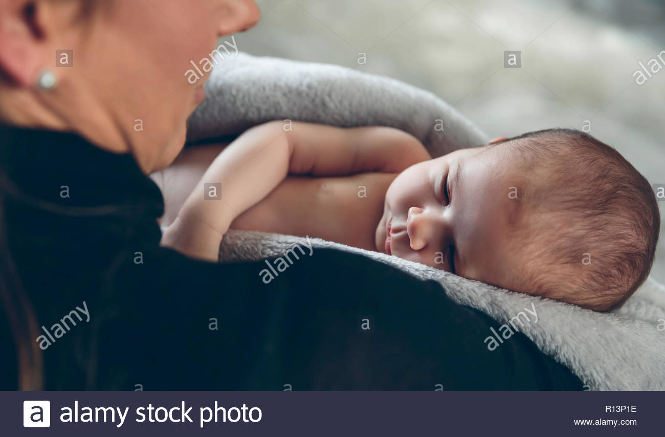 Midsection of a mother and her baby boy - Stock Image