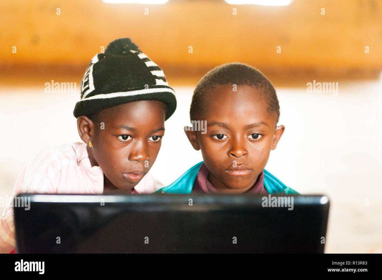 Bafoussam, Cameroon - 06 august 2018: african children, in classroom looking at laptop screen learning to use new technology Stock Photo