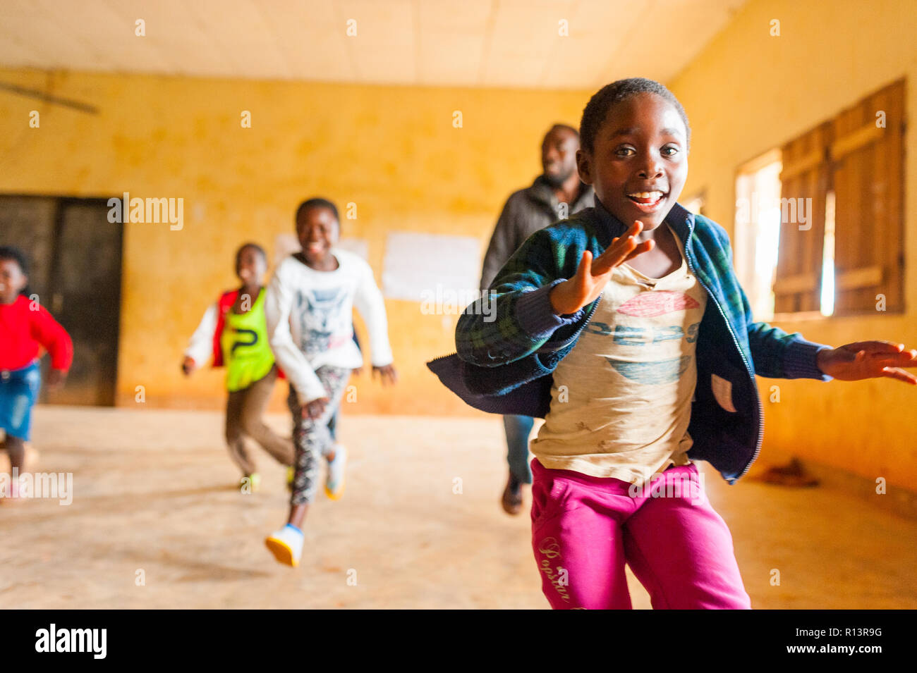 Bafoussam Cameroon  Young Smiling African Girls And Boys Running And