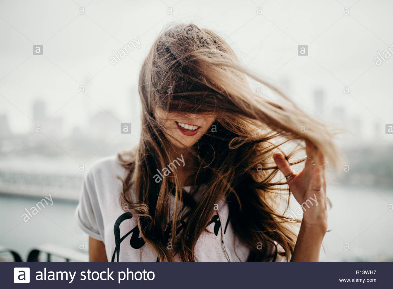 A brunette woman with windswept hair - Stock Image