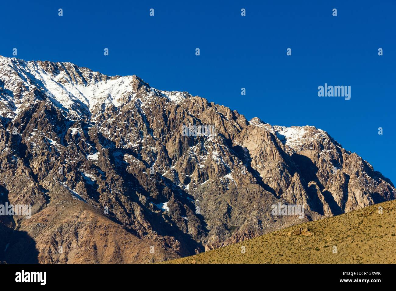 Snow peaks of Andes mountain range under intense blue sky in Elqui Valley, Chile. Exploration hike, trekking adventure concept - Stock Image