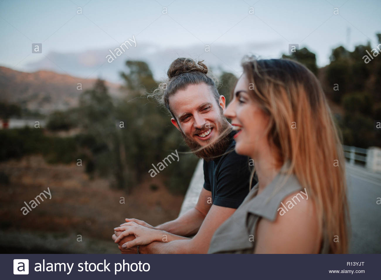 A happy young couple outdoors - Stock Image
