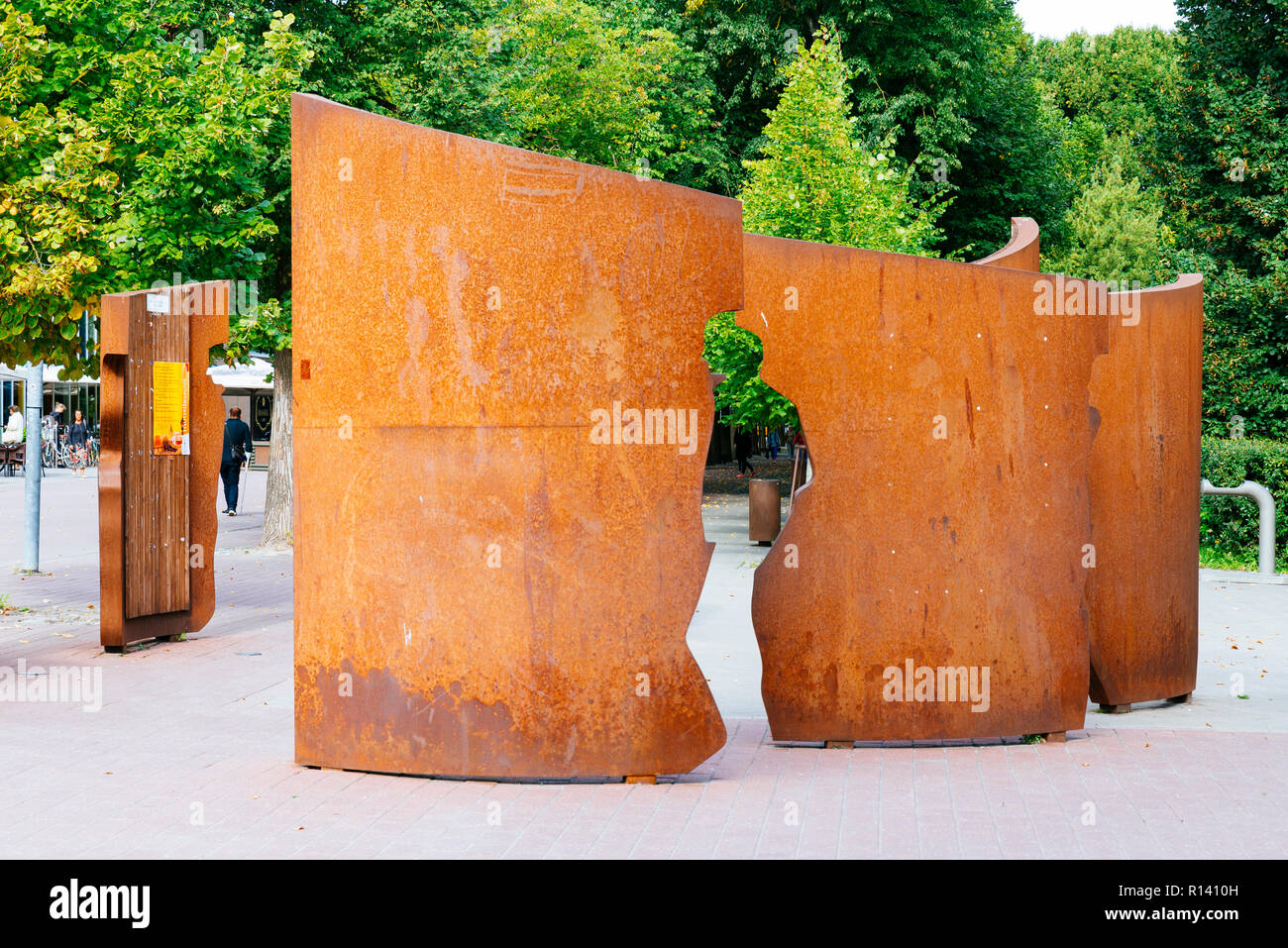 Culture Vessel, sculptural group. Eight corten steel 'planks' represent a ship. Most of the edges of the planks show a half figure, looking from the r - Stock Image