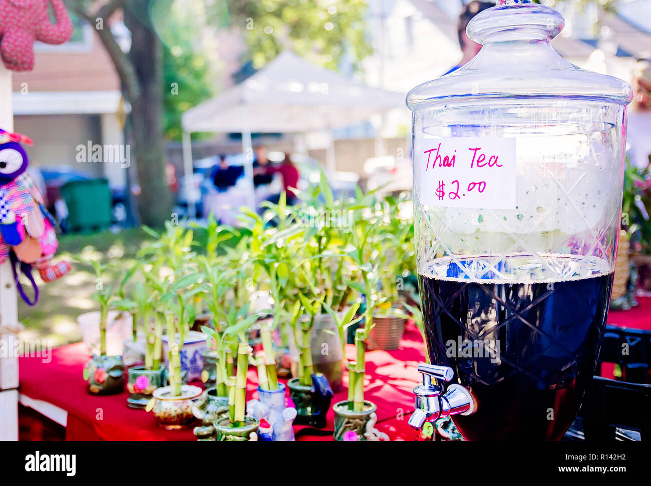 Thai tea is and bamboo is for sale at the Bamboo Garden vendor booth at Market in the Park in Cathedral Square, Nov. 3, 2018, in Mobile, Alabama. - Stock Image