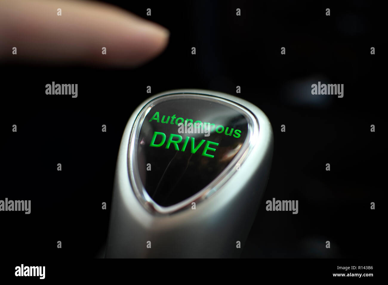 Autonomous drive button in an electric car - Stock Image