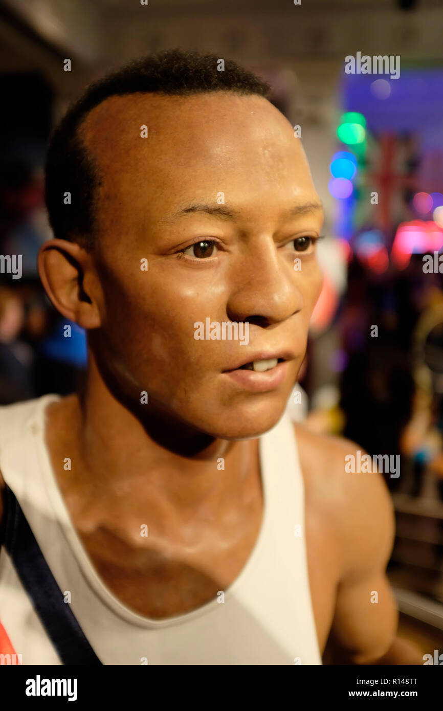 Wax figure of african-american athlete Jesse Owens at world renowned tourist attraction Madame Tussauds Wax museum in London, United Kingdom. Stock Photo