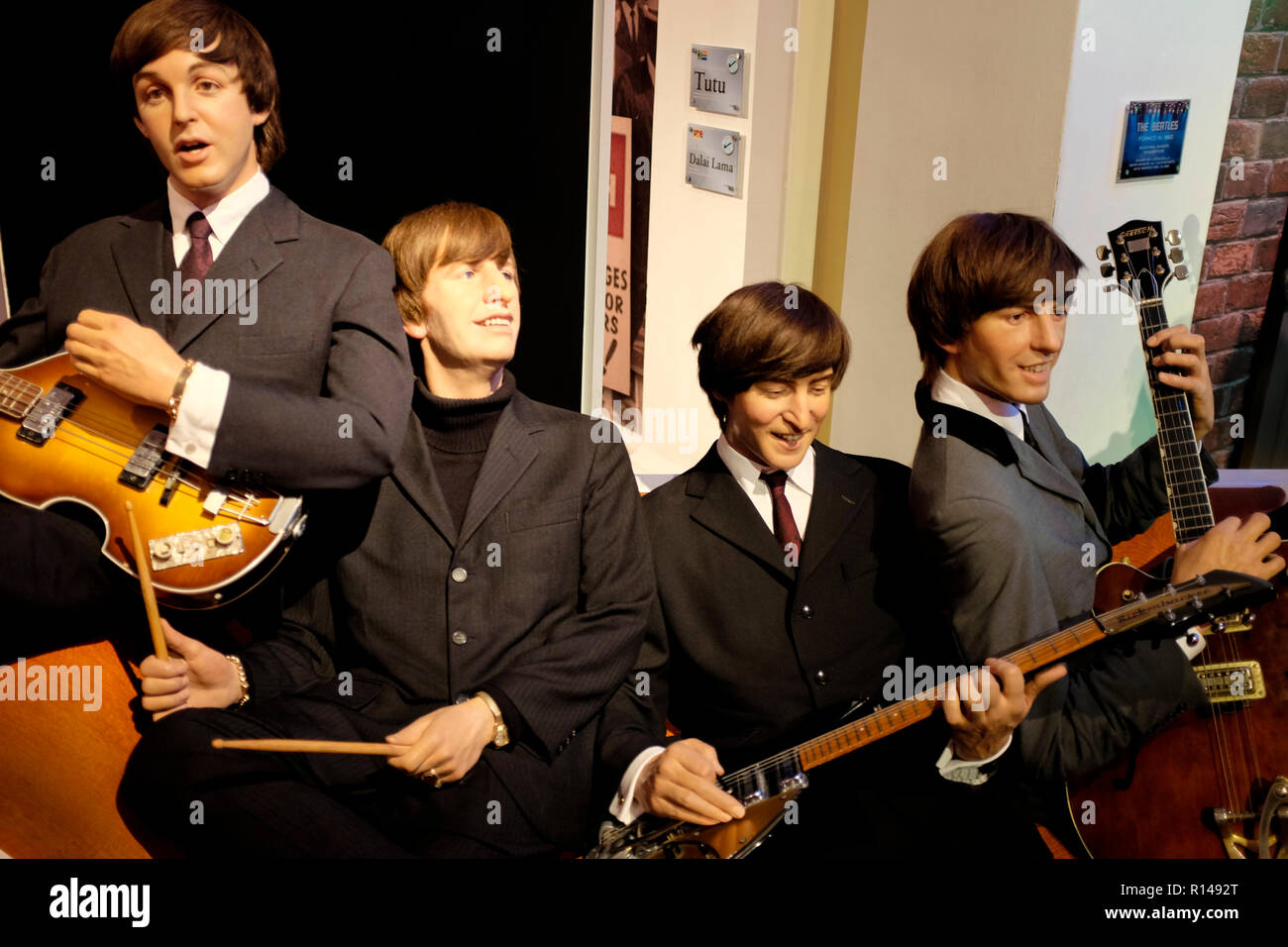 Wax figure of the Beatles at world renowned tourist attraction Madame Tussauds Wax museum in London, United Kingdom. - Stock Image