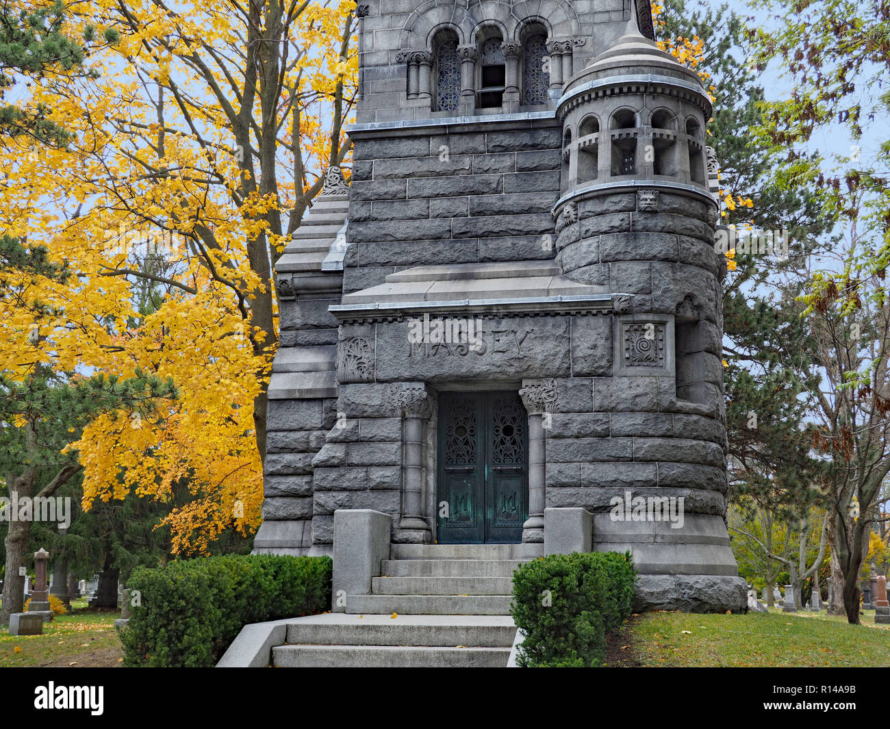 Mount Pleasant Cemetery is an old cemetery in a park-like setting with mature trees and some large family mausoleums. Massey Family Mausoleum. - Stock Image