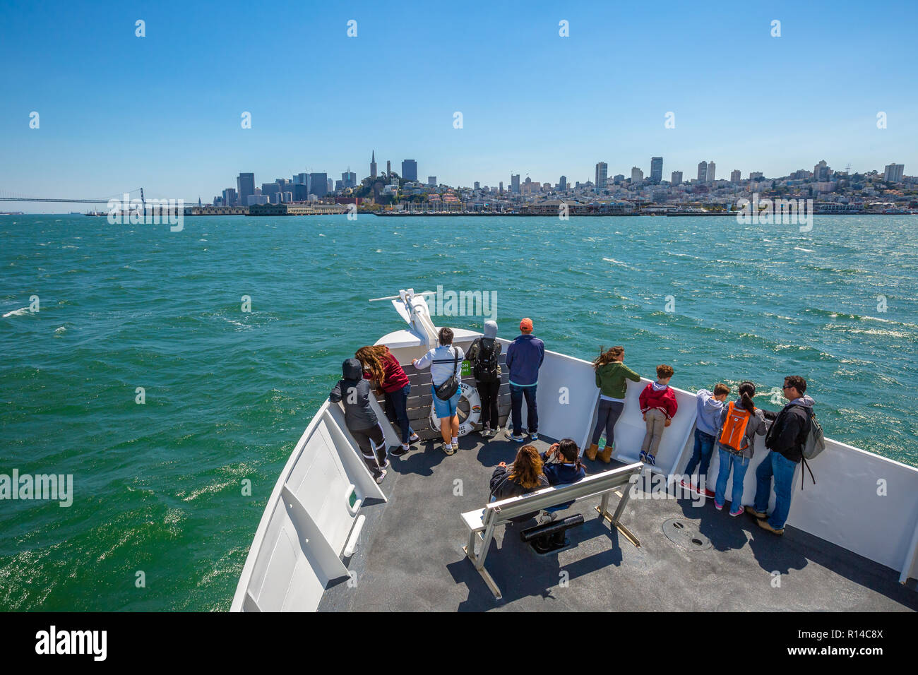San Francisco, California, United States - August 14, 2016: Alcatraz Flayer boat cruise prow with tourists to Francisco cityscape. Alcatraz Island remains one of San Francisco's most popular cruises. - Stock Image