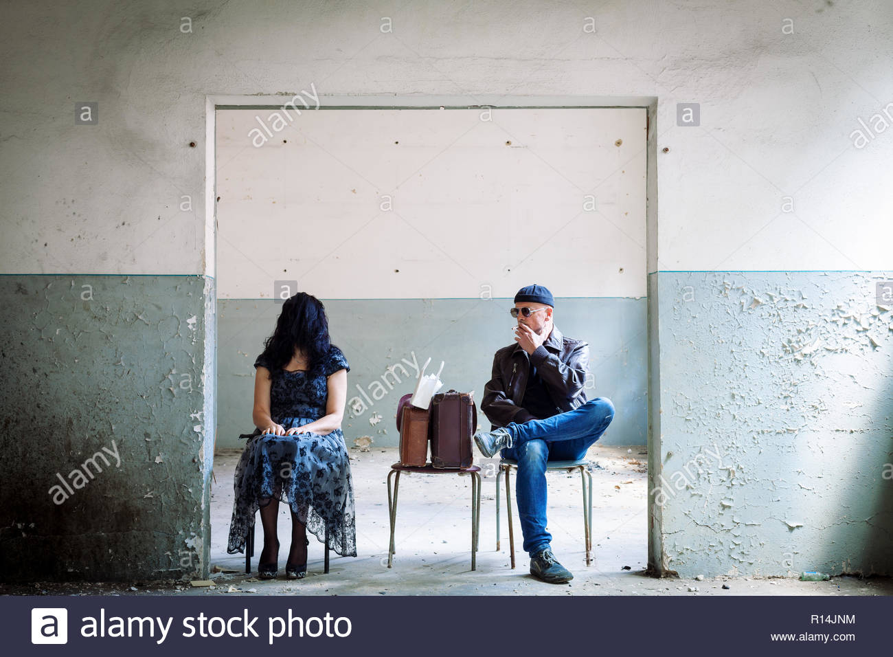 Two strangers sitting on a chair - Stock Image