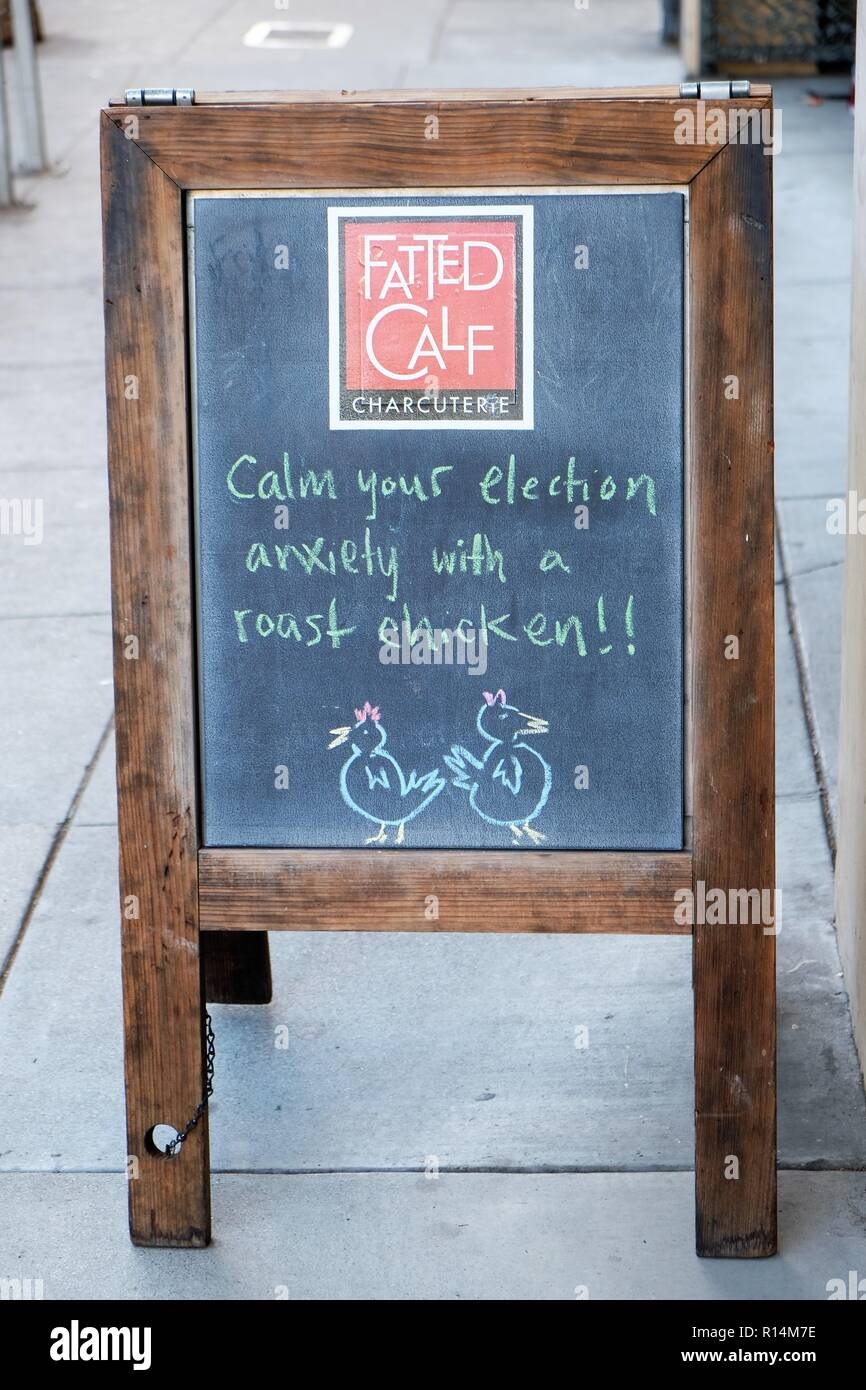 Sidewalk sign outside a Fatted Calf restaurant in San Francisco, California, USA; comical approach to anxiety about the 2018 midterm elections. - Stock Image