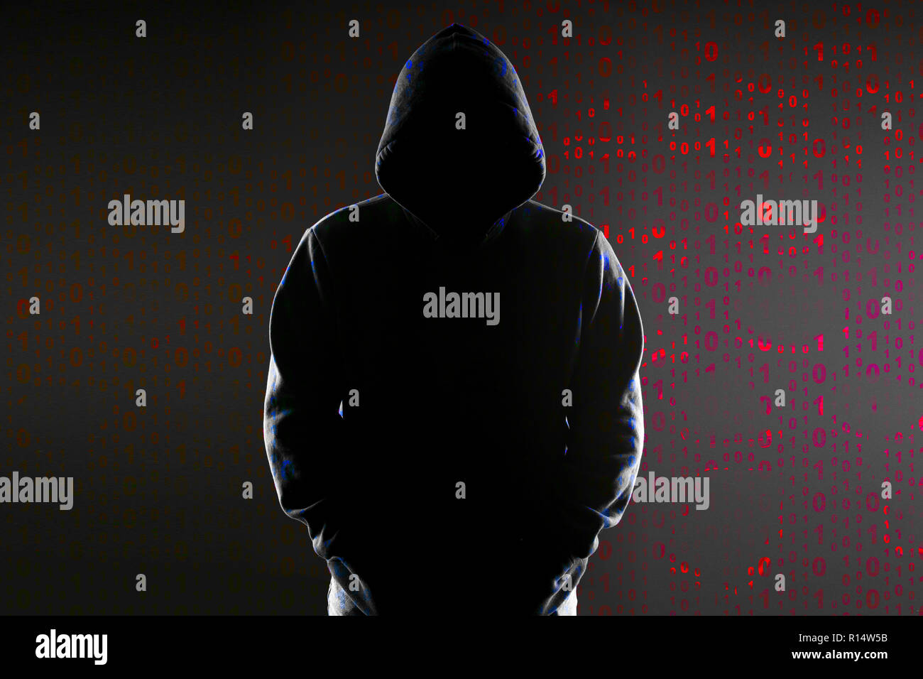 Silhouette Of An Anonymous Hacker In The Hood On The Background Of The Binary Code Stock Photo Alamy