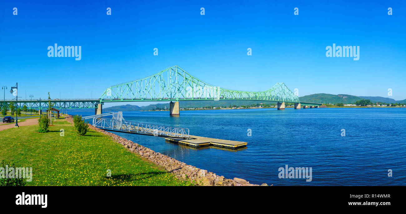 Panoramic view of the J.C. Van Horne Bridge, crossing the Restigouche River between Campbellton, New Brunswick and Pointe-a-la-Croix, Quebec. Canada - Stock Image