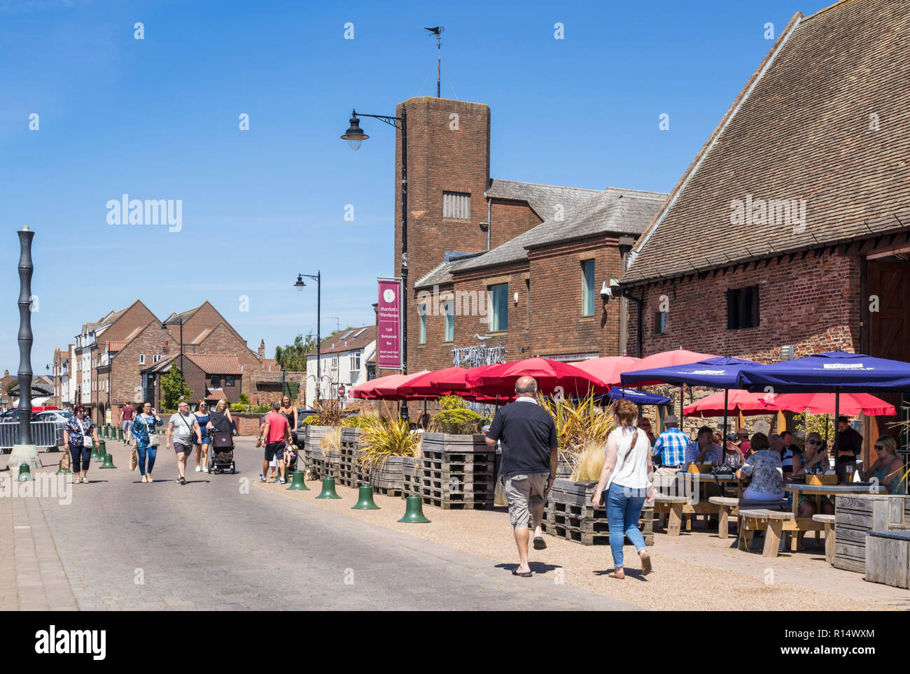 King's Lynn Norfolk People walking past Marriott's Warehouse a16th-century warehouse with a restaurant South Quay King's Lynn England GB UK Europe - Stock Image