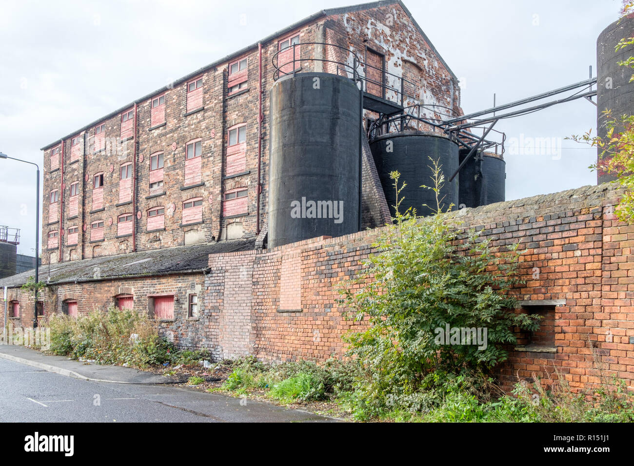 Old factory buildings in the vicinity of Granary Wharf in the city centre of Leeds, which is the largest town in West Yorkshire. Stock Photo