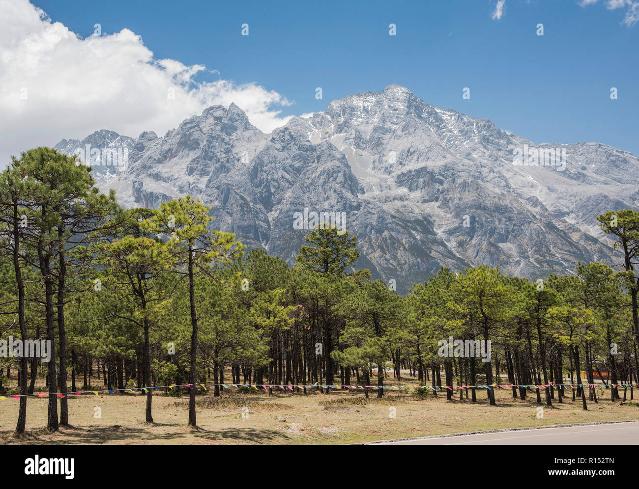 Snow covered Jade Dragon Mountains in the Yunnan province of China. - Stock Image
