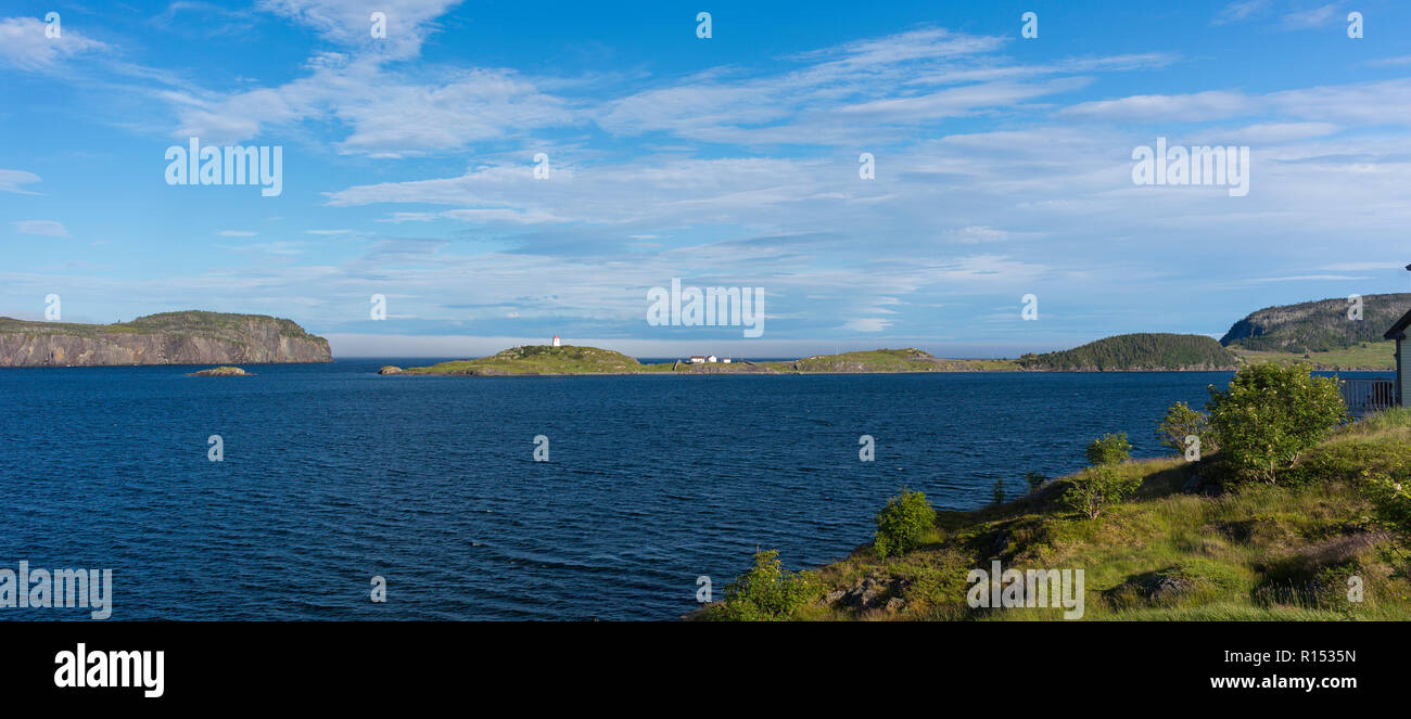 TRINITY, NEWFOUNDLAND, CANADA - Trinity Bay, and Fort Point lighthouse in distance. - Stock Image