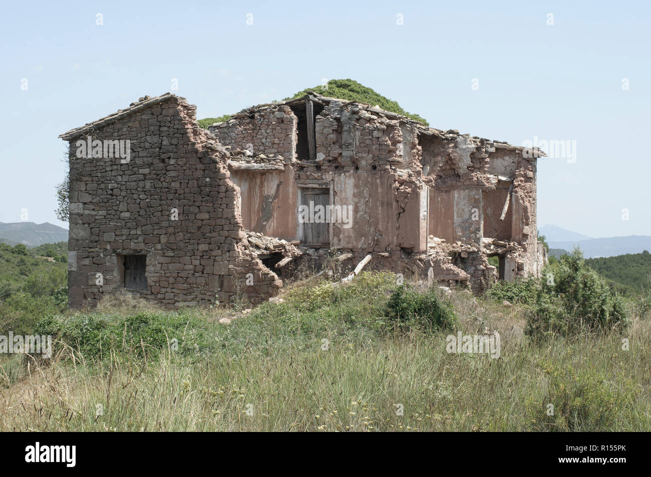 Typical Catalan farmhouse abandoned in ruins - Stock Image