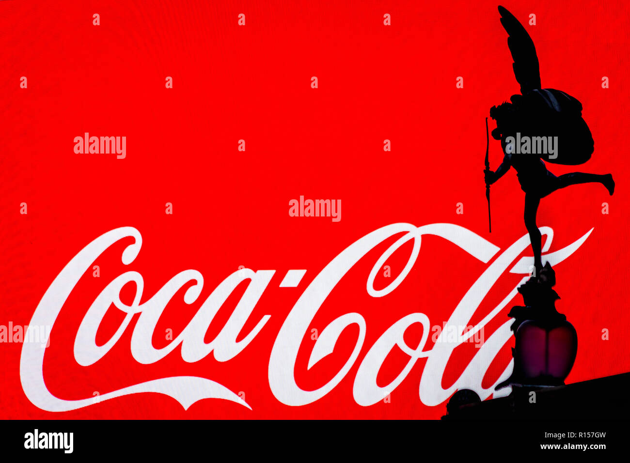 London, UK - August 28, 2018 - silhouette of Cupid statue on Piccadilly Circus square, logo Coca-Cola on the advertisement in the background - Stock Image