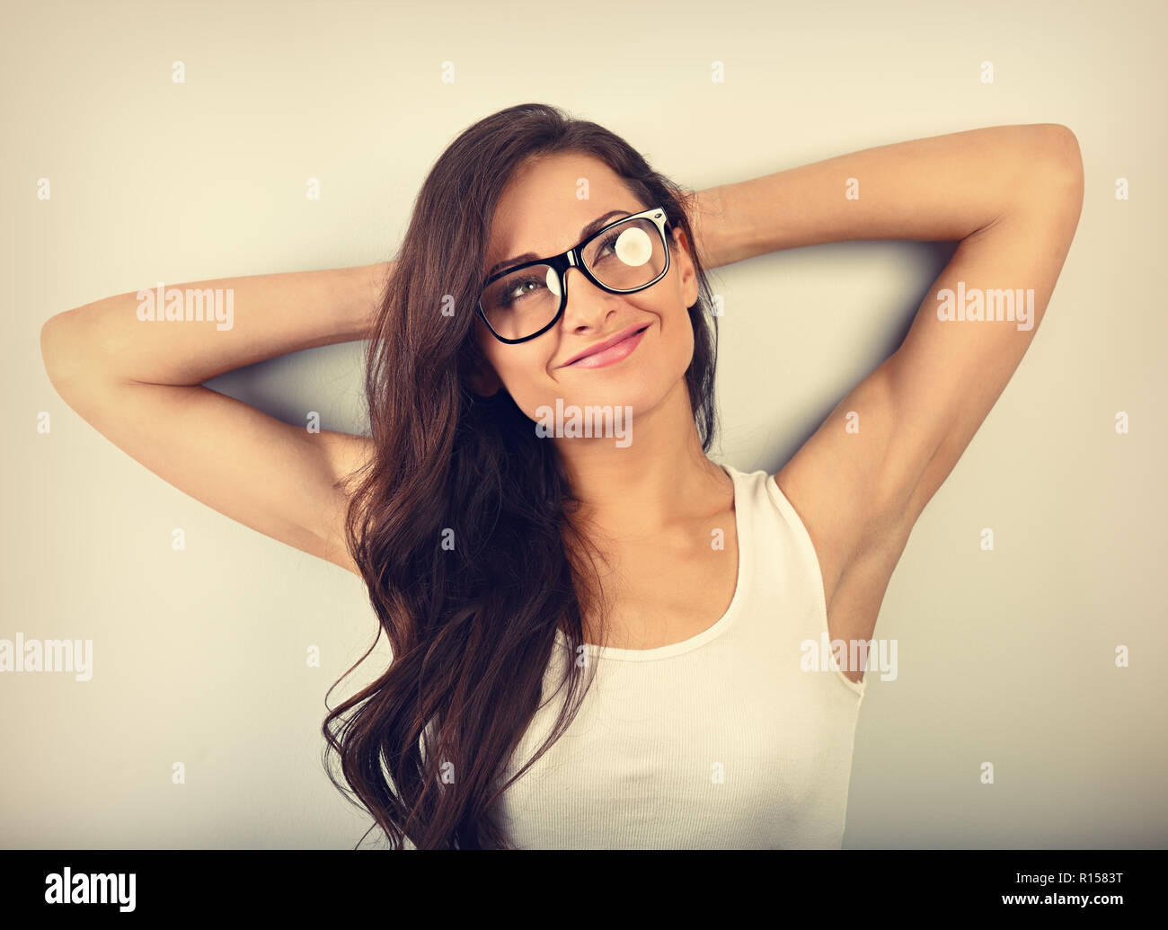 586d3b1a95 Beautiful relaxing woman in glasses dreaming with thinking look up on empty copy  space. Closeup