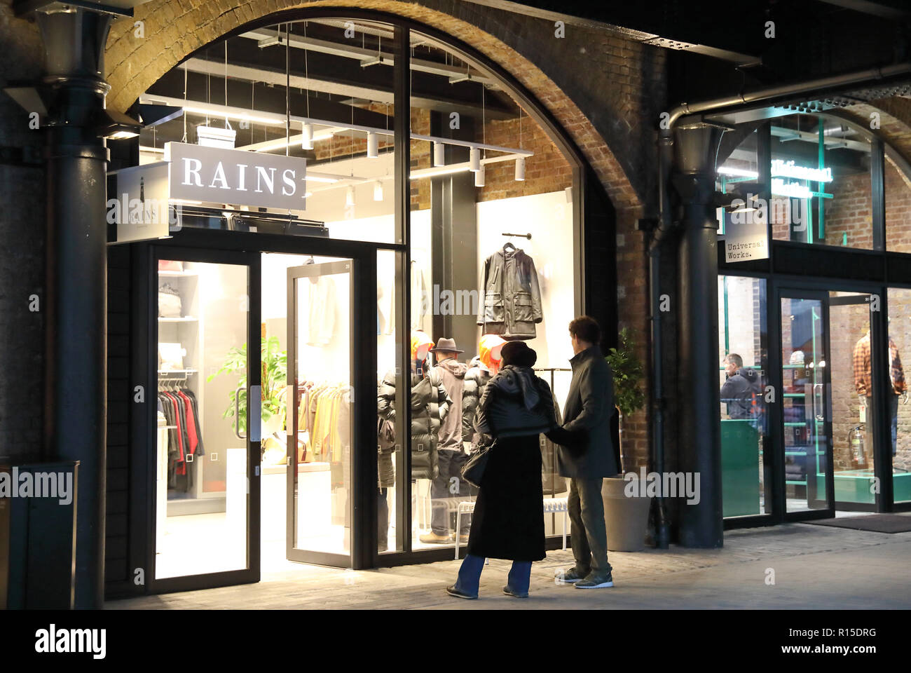 Rains fashion store on yard level at Coal Drops Yard, the new canalside shopping development at Kings Cross, London, UK - Stock Image