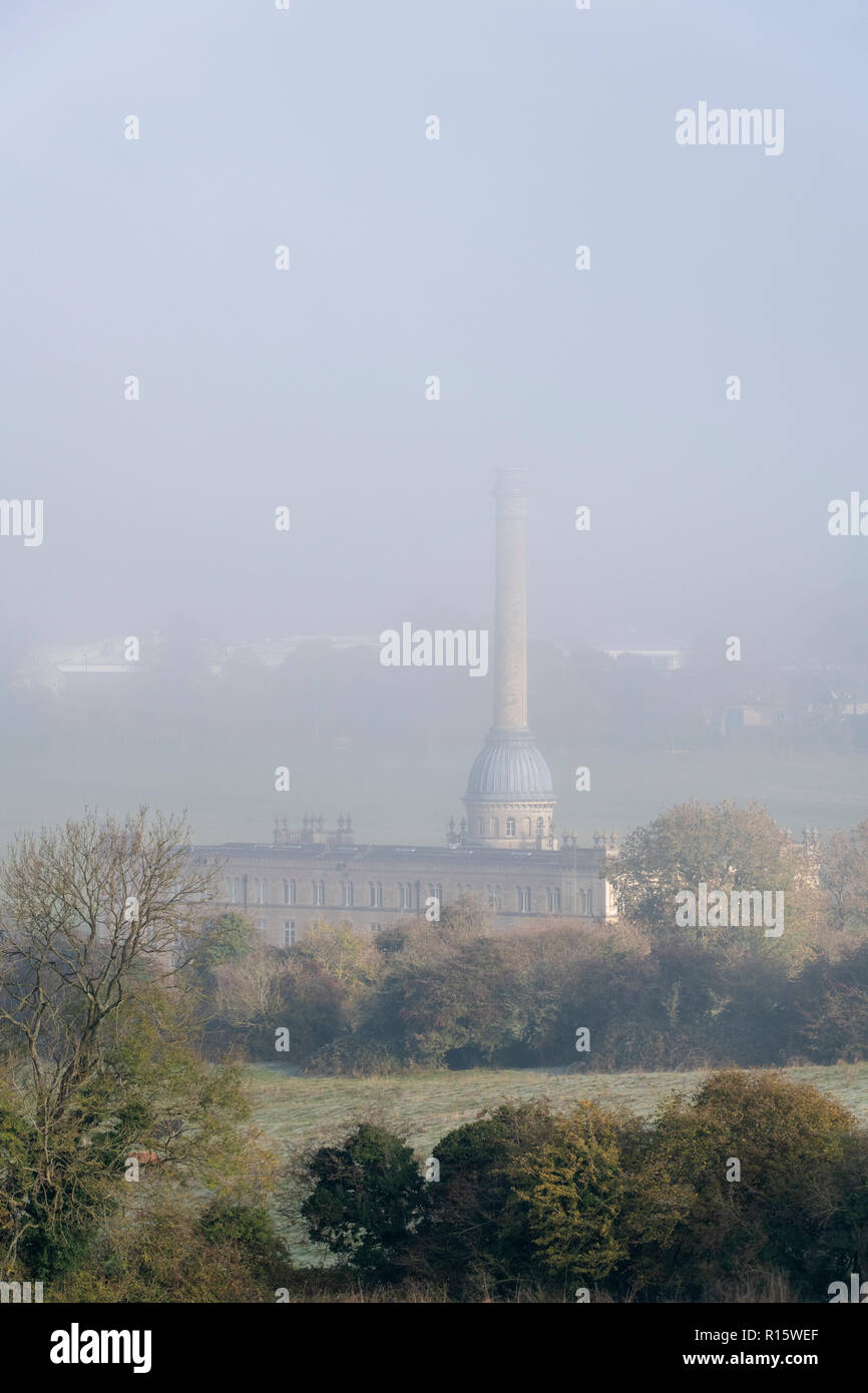 Early morning fog over Bliss Tweed Mill in autumn. Chipping Norton, Cotswolds, Oxfordshire, England Stock Photo