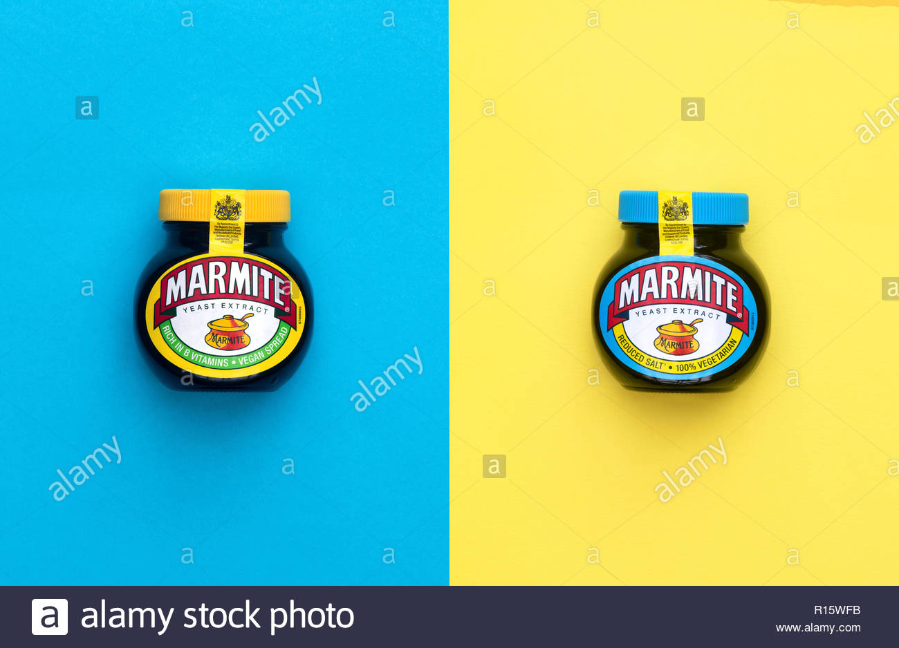 Original Marmite and reduced salt marmite on on a yellow and blue background - Stock Image
