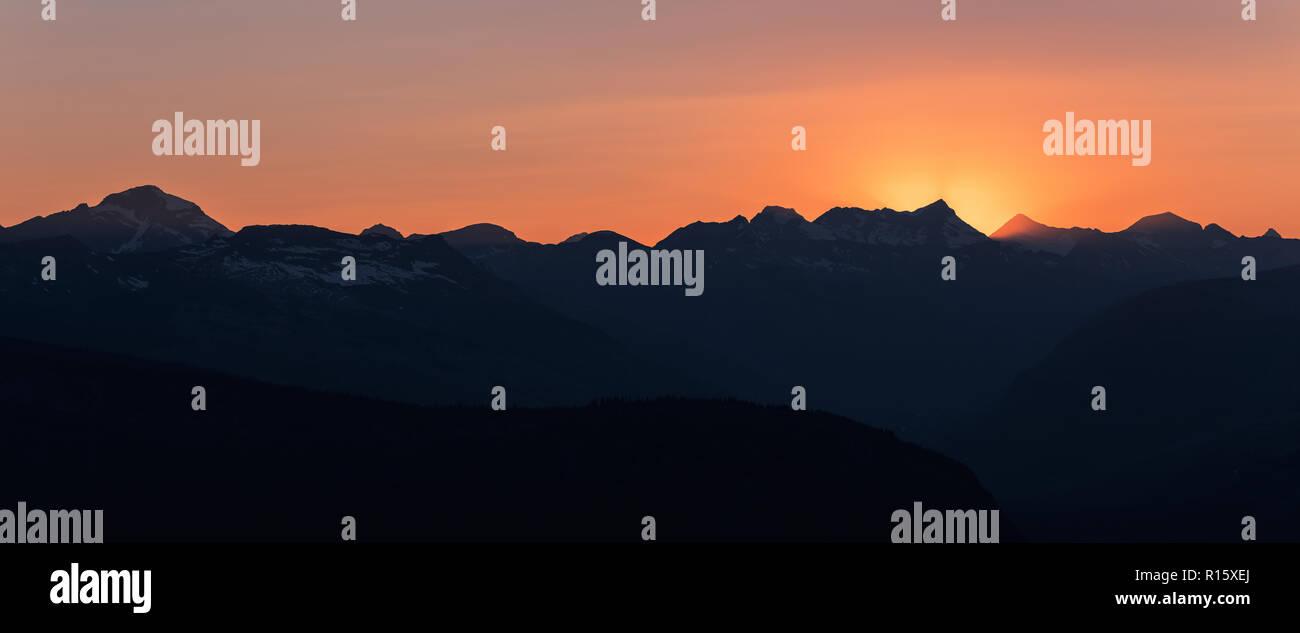 Dramatic sun rays behind Heaven's Peak, Glacier National Park, Montana - Stock Image