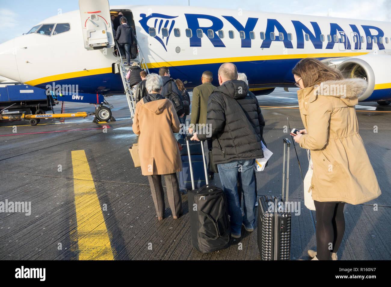 Passengers boarding a Ryanair plane at Dublin Airport Stock Photo