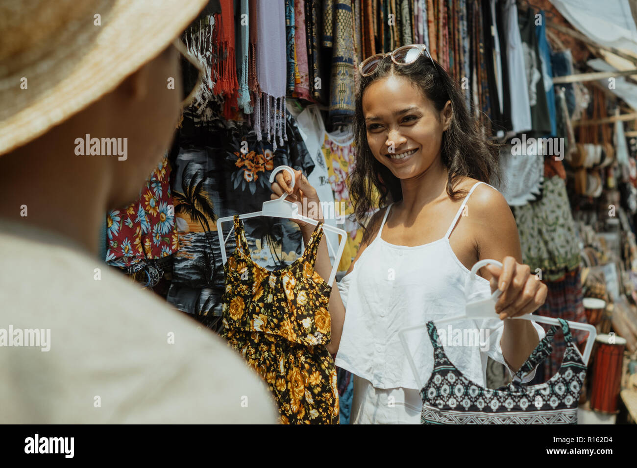 woman buying some clothes in souvenir shop - Stock Image