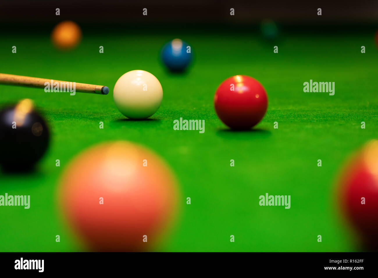 snooker game shot - player aiming the cue ball - Stock Image