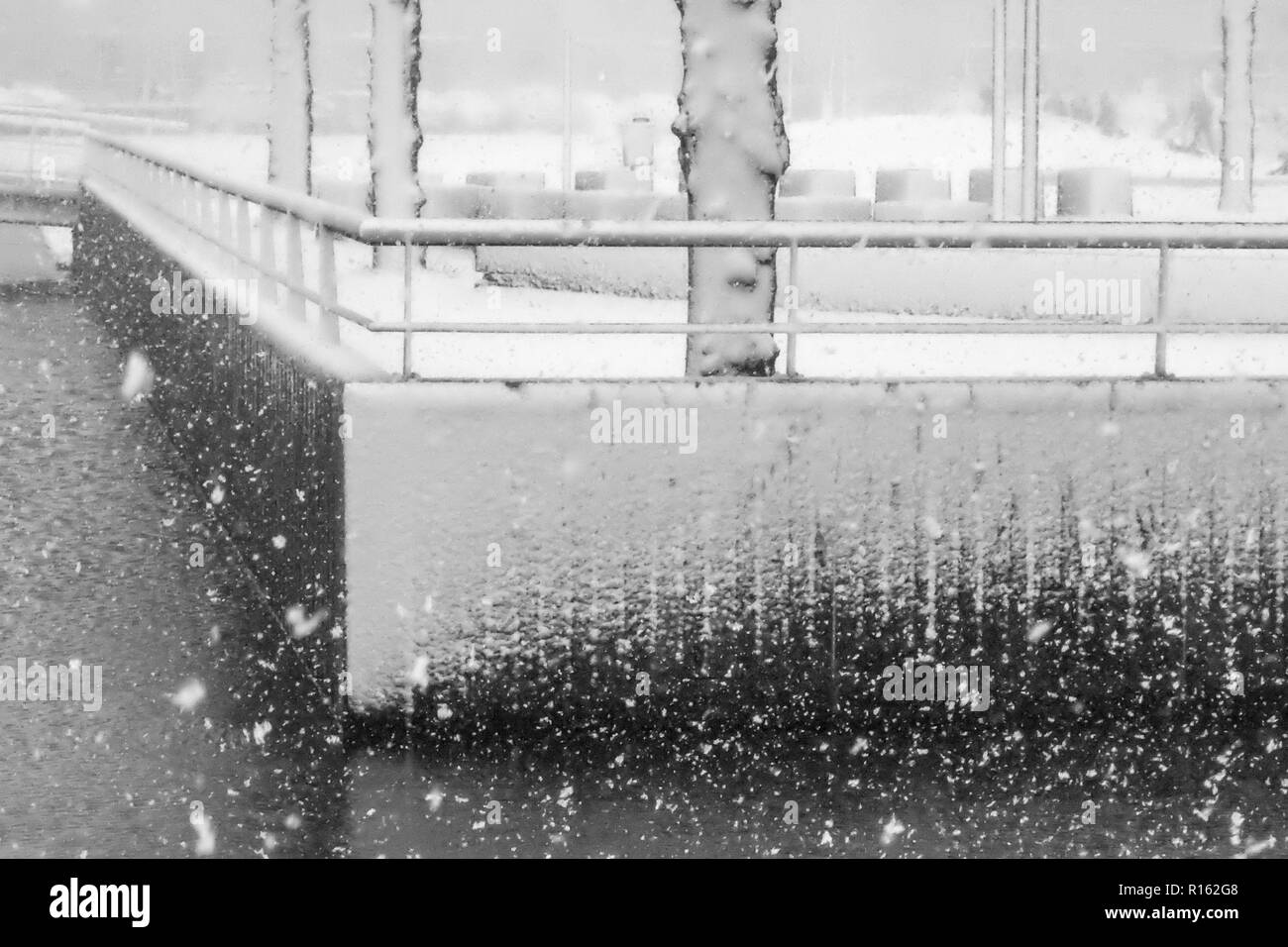 Snowfall in combination with a strong wind causinginteresting patterns. An active front moved slowly over the Netherlands, causing prolific snowfall. - Stock Image