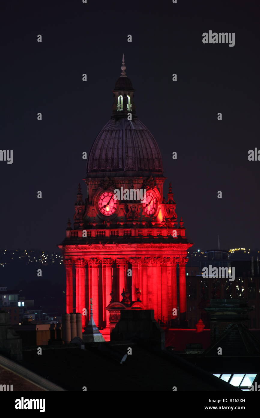 The dome roof of Leeds Town Hall lit up in red to celebrate Leeds International Film Festival - Stock Image
