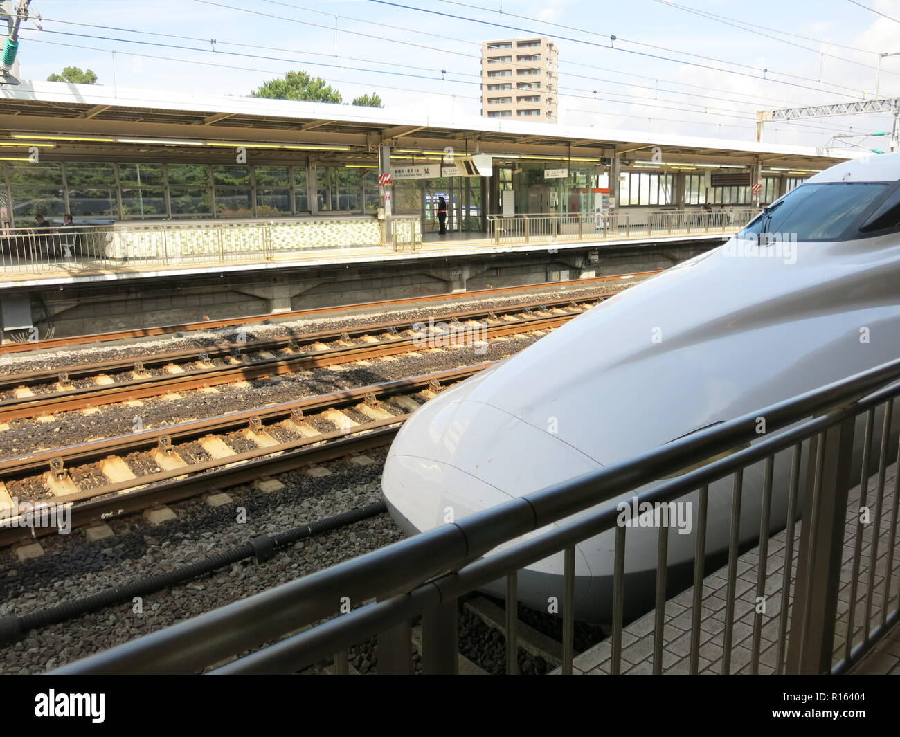 The shiny white sleekness of Japan's Bullet Train is an iconic sight in railway engineering - Stock Image